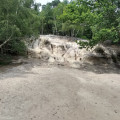 Sandstone outcrop and 'beach' below it, in Rackham